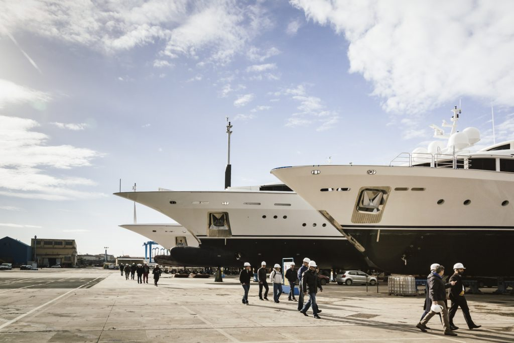 superyacht captains walking around shipyard during YARE refit event