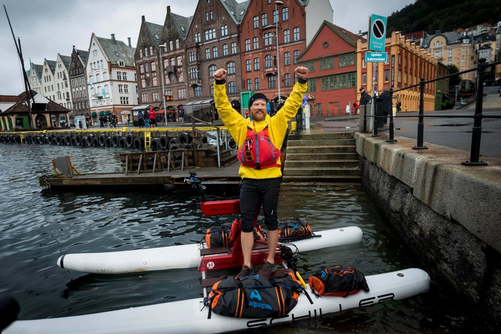 Dave is victorious in Bergen at the end of his Schiller Water Bike Challenge
