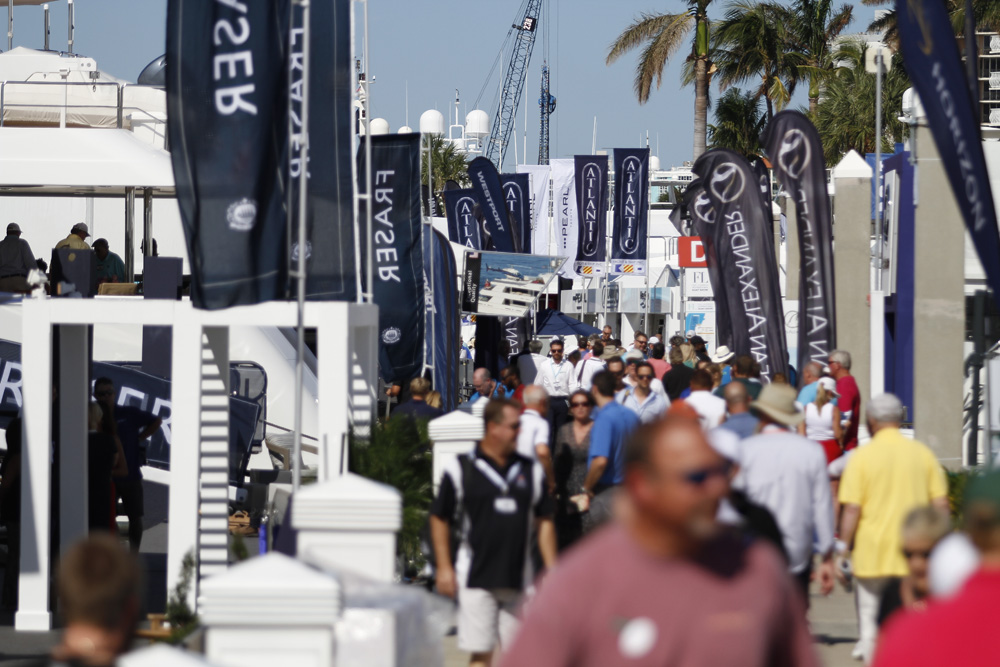 Fort Lauderdale International Boat Show superyacht visitors walking along the dock