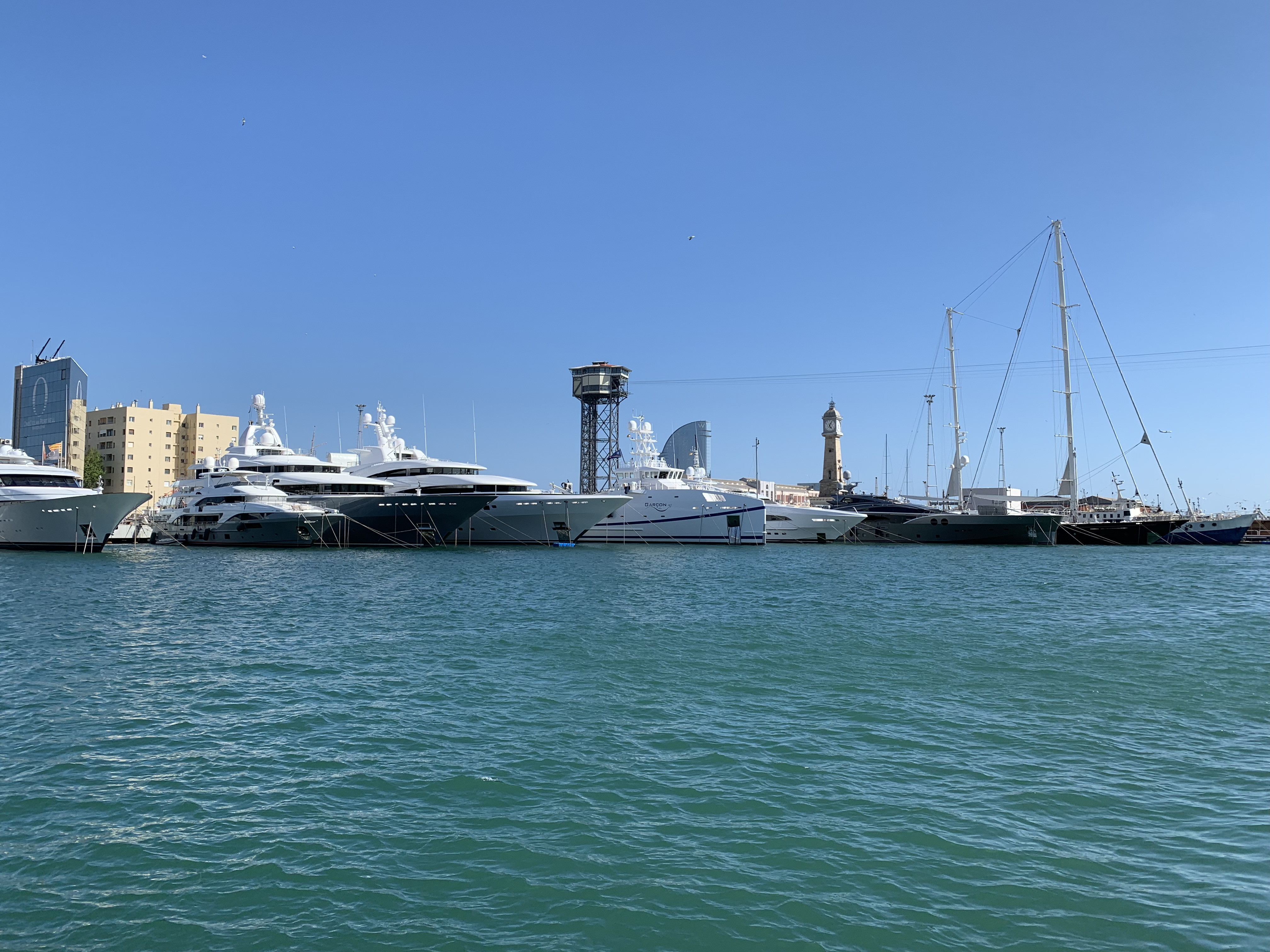 View of superyachts across the harbour at MYBA Charter Show